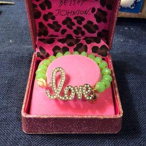 """Betsey Johnson """"Love"""" bracelet."""